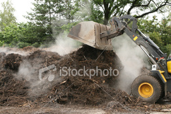 Tractor rearranging compost Royalty Free Stock Photo